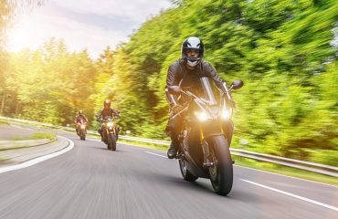 Motorbiker,On,The,Forest,Road,Riding.,Having,Fun,Driving,The